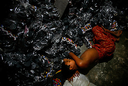 A child labor rests at a shoe factory in Dhaka, Bangladesh.