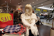 western mannequin display during sale in clothing department store