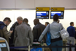 © licensed to London News Pictures. London, UK 29/10/2012. People waiting at a queue for the United Airlines as flights to the east American coast cancelled from Heathrow Airport at Heathrow Terminal 4 due to Hurricane Sandy. Photo credit: Tolga Akmen/LNP