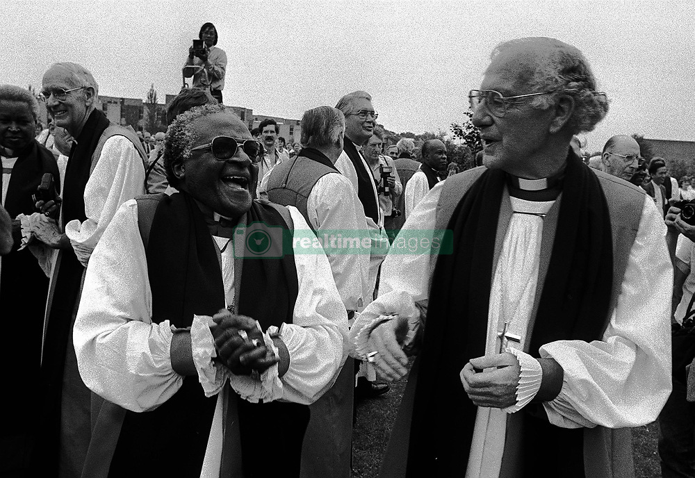 Archbishop Desmond Tutu in good form with the Archbishop of Canterbury, Dr Robert Runcie, at the university of Kent as the Lambeth Conference delegates massed for the official group photograph.