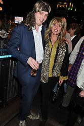 HARRY GRENFELL and PATI BOYD at the Wild for WSPA dinner in aid of the charity World Society for the Protection of Animals held at Under The Bridge, Stamford Bridge, Fulham Road, London on 23rd February 2012.