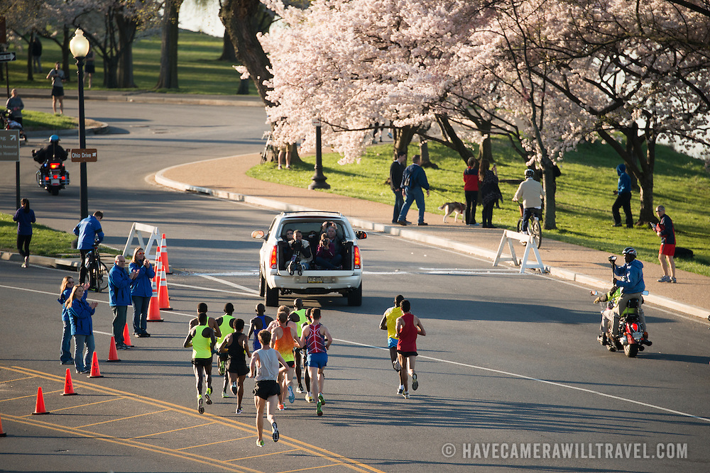 Leaders of the men's race of the 2015 Credit Union Cherry Blossom 10 Mile Run pass the 4-mile mark of the race. The Cherry Blossom 10-Miler (formally the Credit Union Cherry Blossom 10 Mile Run) is held each spring during the National Cherry Blossom Festival and attracts tends of thousands of runners.