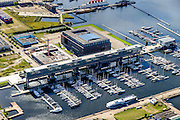 Nederland, Noord-Holland, Amsterdam, 27-09-2015;<br /> Amsterdam-Noord, NDSM-werf, westelijk deel met jachthaven. Kraanspoor.<br /> Amsterdam-North, former dry docks for ship repair, now marina. Urban development.<br /> luchtfoto (toeslag op standard tarieven);<br /> aerial photo (additional fee required);<br /> copyright foto/photo Siebe Swart