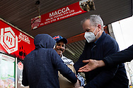 Former Labor Leader Bill Shorten (R) is seen wearing a facemask as he helps a young boy load meat into a truck from Macca Halal Foods in Flemington to help feel the people affected by the housing commission tower lockdown during COVID-19 on 10 July, 2020 in Melbourne, Australia. Former Federal Labor Leader Bill Shorten, along with close allies at Trades Hall help deliver Halal meat, supplied by Macca Halal Foods to the locked down housing commission towers following a coronavirus outbreak detected inside the complex. Mr Shorten was able to use his high profile to ensure food was not turned away by police so that it would reach the residents inside. (Photo be Dave Hewison/ Speed Media)