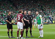 The William Hill Scottish FA Cup Final 2012 Hibernian Football Club v Heart Of Midlothian Football Club..19-05-12...Hearts Captain Marius Zaliukas and Hibs captian James McPake at the Coin toss with Referee Craig Thomson, with Assistants Derek Rose and Alasdair Ross.         during the William Hill Scottish FA Cup Final 2012 between (SPL) Scottish Premier League clubs Hibernian FC and Heart Of Midlothian FC. It's the first all Edinburgh Final since 1986 which Hearts won 3-1. Hearts bid to win the trophy since their last victory in 2006, and Hibs aim to win the Scottish Cup for the first time since 1902....At The Scottish National Stadium, Hampden Park, Glasgow...Picture Mark Davison/ ProLens PhotoAgency/ PLPA.Saturday 19th May 2012.
