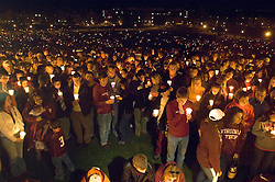 Blacksburg, Va. UNITED STATES: Mourners grieve at a candlelight vigil for the victims of the shooting massacre at Virginia Tech University in Blacksburg, Virginia April 17, 2007. A 23-year-old student from South Korea was identified as the gunman who carried out the deadliest school shooting in US history.  33 people died on Monday, police named the gunman as Cho Seung-Hui, a student at the school and resident alien in the United States. (AMi Vitale)