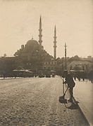 Historical view of the Yeni Cami Mosque seen from the Galata Bridge Istanbul Turkey.