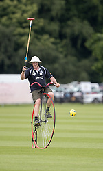 A Scotland team member competes against England in the Penny Farthing International Polo match during the Bentley Motors Royal Windsor Cup Final at at Guards Polo Club, Windsor Great Park, Egham, Berkshire.