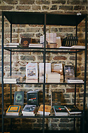 Books on display at Pages bookshop and cafe. The building has been restored, including the exposed brick work.