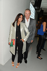 JACKIE ST.CLAIR and CARL MICHAELSON at the Audemars Piguet Royal Oak Offshore 42mm Party held at Victoria House, Bloomsbury Square, London on 23rd April 2014.