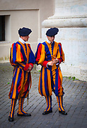 Swiss Guards at Saint Peter's Cathedral in Rome, Italy.  Swiss Guards are the Swiss soldiers who have served as bodyguards, ceremonial guards, and palace guards at foreign European courts since the late 15th century. Apart from household and guard units, regular Swiss mercenary regiments have served as line troops in various armies; notably those of France, Spain and Naples up to the 19th century (see Swiss Mercenaries). In contemporary usage, the name Swiss Guards generally refers to the Pontifical Swiss Guard of Holy See.<br /> Various units of Swiss Guards existed for hundreds of years. The earliest such unit was the Swiss Hundred Guard (Cent Suisses) at the French court (1497 – 1830). This small force was complemented in 1567 by a Swiss Guards regiment. The Papal Swiss Guard (now located in the Vatican City State), was founded in 1506 and is the only Swiss Guard that still exists. In the 18th and early 19th centuries several other Swiss Guards existed for periods in various European courts.<br /> The use of Swiss soldiers as Royal guards and as the Pontifical guard stems from the reputation of Swiss mercenaries at the time of their formation. Since Switzerland was a poor country, young men often sought their fortunes abroad. Having a reputation for discipline and loyalty, and employing revolutionary battle tactics, they were considered the most powerful troops of the 15th century, until their methods were refined by the Landsknechte in the early 16th century.