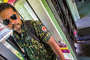 27 OCTOBER 2012 - SUNGAI KOLOK, NARATHIWAT, THAILAND:     A civil defense volunteer on duty on a northbound train out of Sungai Kolok, Thailand. Sungai Kolok has been a center of extremist violence. Several car bombs have been detonated in the city, which is on the Malaysian border and very popular with Malaysian tourists. More than 5,000 people have been killed and over 9,000 hurt in more than 11,000 incidents, or about 3.5 a day, in Thailand's three southernmost provinces and four districts of Songkhla since the insurgent violence erupted in January 2004, according to Deep South Watch, an independent research organization that monitors violence in Thailand's deep south region that borders Malaysia.   PHOTO BY JACK KURTZ
