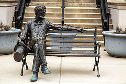 the McLean County Museum of History Lincoln Statue has been closed due to the COVID-19 (Novel Coronavirus) and the bench seat statue of Abraham Lincoln is unusually all alone.