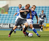 Photo: Chris Ratcliffe.<br />Millwall v Crystal Palace. Pre Season Friendly. 29/07/2006.<br />Sandor Torghelle (L) of Crystal Palace clashes with Paul Robinson of Millwall.