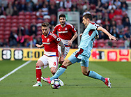 Adam Clayton of Middlesbrough in action with Stephen Ward of Burnley during the Premier League match at the Riverside Stadium, Middlesbrough. Picture date: April 8th, 2017. Pic credit should read: Jamie Tyerman/Sportimage