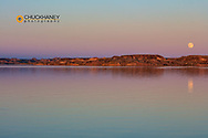 Full moonrise over Fort Peck Reservoir in the CM Russell National Wildlife Refuge near Fort Peck, Montana, USA