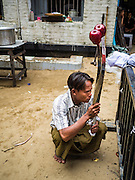 24 OCTOBER 2015 - YANGON, MYANMAR: A Shia man waits for a procession to start at Punja Mosque on Ashura in Yangon. Ashura commemorates the death of Hussein ibn Ali, the grandson of the Prophet Muhammed, in the 7th century. Hussein ibn Ali is considered by Shia Muslims to be the third imam and the rightful successor of Muhammed. He was killed at the Battle of Karbala in 610 CE on the 10th day of Muharram, the first month of the Islamic calendar. According to Myanmar government statistics, only about 4% of the population is Muslim. Many Muslims have fled Myanmar in recent years because of violence directed against Burmese Muslims by Buddhist nationalists.    PHOTO BY JACK KURTZ