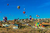 Hot air balloons landing near houses, Albuquerque International Balloon Fiesta, Albuquerque, New Mexico USA.