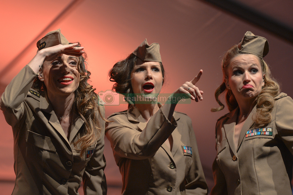 June 4, 2017 - Arromanches-Les-Bains, Normandy, France - A French trio 'Girly Swing' dressed in US ARmy 1944 uniforms perform in front of crowd in Arromanches during D-Day Festival Normandy 2017. .Tuesday 6th June is the 73rd anniversary of the D-Day landings which saw 156,000 troops from the allied countries including the United Kingdom and the United States join forces to launch an audacious attack on the beaches of Normandy..On Monday, June 5, 2017, in Arromanches-les-Bains, France. (Credit Image: © Artur Widak/NurPhoto via ZUMA Press)