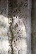 Close update of elaborately decorated stone 12th century Norman arch in doorway entrance to the historic village parish church  Marden, Wiltshire, England, UK