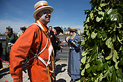 May Day custom of Deptford Jack in the Green, a man encased in a framework entirely covered with greenery, is one of the lesser-known modern revivals by the Blackheath Morris Men of English traditional customs on May 1st 2016 in London, United Kingdom. Working its route along the river, the Jack reaches Greenwich. Fowlers Troop Jack in the Green was revived in the early 1980s. Originally a revival from about 1906, it developed from the 17th Century custom of milkmaids going out on May Day with the utensils of their trade, decorated with garlands of flowers and piled into a pyramid which they carried on their heads. By the mid eighteenth century other groups, notably chimney sweeps, were moving in on the milkmaids territory as they saw May Day as a good opportunity to collect money, so carried a Jack in the Green. Over the last 25 years several popular festivals have grown up around the Jack in the Green tradition. Deptford Jack in the Green is not very widely known although it has been running since the early 1980s.