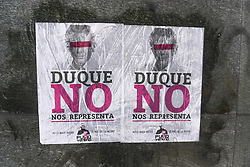 May 1, 2019 - Bogota, Colombia - A poster stuck on a wall, which says ''Duque Does not Represent Me'' is seen during march to Labour Day celebrations in Bogota, Colombia on May 01, 2019. (Credit Image: © Daniel Garzon Herazo/NurPhoto via ZUMA Press)