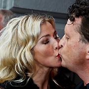 NLD/Amsterdam/20100801 - Inloop premiere musical Crazy Shopping, Brigitte Nijman en partner Robert Veuger