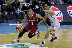 QUEZON Quezon City, May 13, 2017  Wei Long Wong of Singapore (L) competes against Allein Maliksi of the Philippines (R) during their match in the 2017 SEABA senior men's championship tournament in Quezon City, the Philippines, May 13, 2017. The Philippines won, 113-66.  2017?5?13? (Credit Image: © Rouelle Umali/Xinhua via ZUMA Wire)