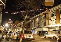 The crew from Metrocast came out late Wednesday evening to set the Christmas lights adding holiday sparkle throughout downtown Main Street.  (Karen Bobotas/for the Laconia Daily Sun)