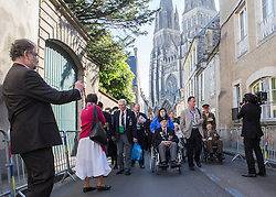 © Licensed to London News Pictures. 06/06/2014. Bayeux, Normandy.  Veterans and their guests  made the short journey from Bayeux cathedral to the British Military service to attend a memorial as part of the 70th Anniversary D Day commemorations.   The veterans were met with rounds of applause and cheers by local crowds.   Also in attendance were HRH The Queen and Prince Phillip and various British political figures.  Photo credit : Alison Baskerville/LNP