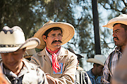 A Mexican cowboy waits for the start of Catholic mass on Cubilete Mountain at the end of the annual Cabalgata de Cristo Rey pilgrimage January 6, 2017 in Guanajuato, Mexico. Thousands of Mexican cowboys and horse take part in the three-day ride to the mountaintop shrine of Cristo Rey.