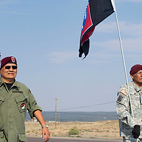 Members of the Tso Dzil Mt. Taylor Color and Honor Guard carry the colors along HW 264 for the Navajo Code Talkers Parade in Window Rock, AZ on Aug. 14, 2018.