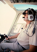 Oil industry Saudi Arabia, helicopter Bell 206 JetRanger 1979 pilot in cockpit wearing funny face mask