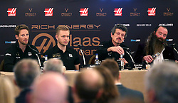 Romain Grosjean, Kevin Magnussen, Team Principal Guenther Steiner and Rich Energy CEO William Storey during the Rich Energy Haas F1 Team 2019 car launch at the Royal Automobile Club, London.