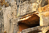 Pictures & images of the ancient Lycian rock cut tomb of a Gladiator whose rock relief sculpture can be seen with his family ,  Myra, Anatolia, Turkey. .<br /> <br /> If you prefer to buy from our ALAMY PHOTO LIBRARY  Collection visit : https://www.alamy.com/portfolio/paul-williams-funkystock/myra-lycian-tombs-turkey.html<br /> <br /> Visit our CLASSICAL WORLD HISTORIC SITES PHOTO COLLECTIONS for more photos to download or buy as wall art prints https://funkystock.photoshelter.com/gallery-collection/Classical-Era-Historic-Sites-Archaeological-Sites-Pictures-Images/C0000g4bSGiDL9rw