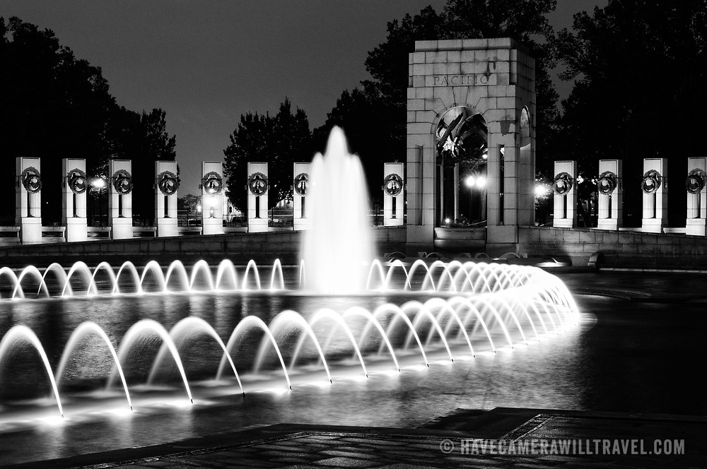 WASHINGTON, DC - The World War II Memorial is dedicated to those who served during World War II in the armed forces or as civilians. It is located on Washington DC's National Mall, between the Washington Monument and the Lincoln Memorial. Its centerpiece is a large fountain surrounded by 56 granite pillars, one for each state and territory, and a pair of small triumphal arches arranged in an oval. It was opened in 2004.