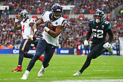 Houston Texan's tight end, Darren Fells (87) scores a touchdown during the NFL game between Houston Texans and Jacksonville Jaguars at Wembley Stadium in London, United Kingdom. 03 November 2019