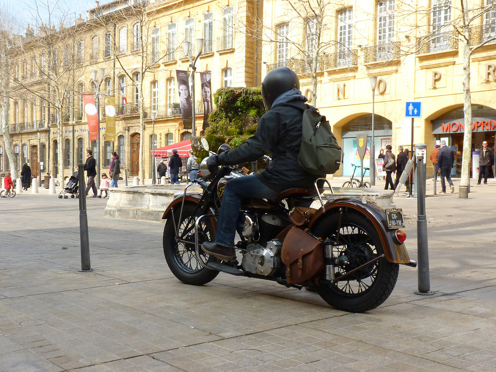 Walking through Aix-en-Provence one morning, we came upon this vintage Indian motorcycle parked in the town square.  As I admired the bike, the owner arrived and was on his way.