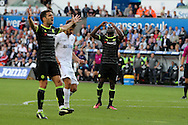 Cesc Fabregas (l) and Victor Moses of Chelsea react and show their frustration after missing a chance to score. Premier league match, Swansea city v Chelsea at the Liberty Stadium in Swansea, South Wales on Sunday 11th Sept 2016.<br /> pic by  Andrew Orchard, Andrew Orchard sports photography.