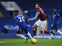 Football - 2020 / 2021 Premier League - Chelsea vs Burnley - Stamford Bridge<br /> <br /> Burnley's Dwight McNeil holds off the challenge from Chelsea's Callum Hudson-Odoi.<br /> <br /> COLORSPORT/ASHLEY WESTERN