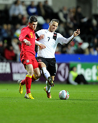 Gareth Bale (Tottenham Hotspur) of Wales  battles for the ball with Marko Arnautovic (Werder Bremen) of Austria  - Photo mandatory by-line: Joe Meredith/JMP - Tel: Mobile: 07966 386802 06/02/2013 - SPORT - FOOTBALL - Liberty Stadium - Swansea  -  Wales V Austria - International Friendly