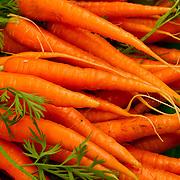 carrots stacked at the Saturday Farmer's Market, Boise, Idaho