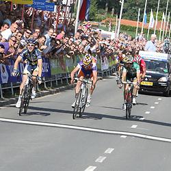 Sportfoto archief 2011<br /> Pim Ligthart pakt in Ootmarsum de titel voor Bram Tankin k en Reinier Honig