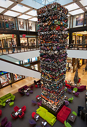 Interior view of modern art sculpture in atrium inside Quartier 205 upmarket shopping mall on Friedrichstrasse in Mitte Berlin 2009