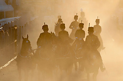 © Licensed to London News Pictures. 24/07/2018. Llanelwedd, Powys, UK. The King's Troop return from the Main Ring aftera spectacular evening show on the second day of the Royal Welsh Show. The Royal Welsh Agricultural Show is hailed as the largest & most prestigious event of its kind in Europe. In excess of 200,000 visitors are expected this week over the four day show period. The first ever show was at Aberystwyth in 1904 and attracted 442 livestock entries. Photo credit: Graham M. Lawrence/LNP