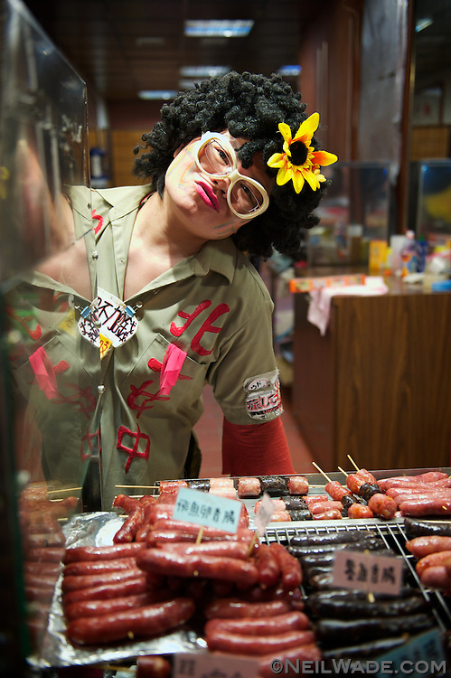 One of the famous vendors dresses uniquely as she sells sausages in Jeoufen, Taiwan.