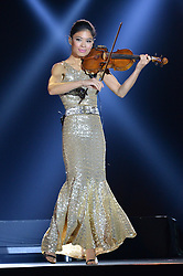 VANESSA MAE performing at Battersea Dogs & Cats Home's Collars & Coats Gala Ball held at Battersea Evolution, Battersea Park, London on30th October 2014.