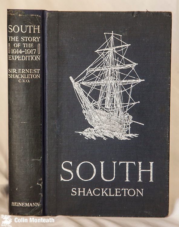 SOUTH, - The Story of Shackleton's last expedition 1914-1917 expedition, Sir Ernest Shackleton, William Heinemann, London, 1st edn 1919, 2nd imp December 1919.. a month after the true first in November 1919 -  A little browning to pages but not as bad as is common with first print run. Professionally repaired with original spine relaid, new endpapers, Original blue cloth unfaded and silver titles and front board decoration of Endurance near mint. All Hurley plates complete, no inscriptions, binding firm, almost no foxing. South is an important polar book that came to define the end of an era of Antarctic exploration. At this price this good copy will sell quickly.  $1850