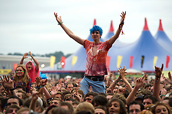 © London News Pictures. 24/08/2012. London, UK. Revelers watching 'You Me And Six' perform on the main stage on day one of Reading Festival 2012 in Reading, Berkshire, UK on August 24, 2012. The three day event which attracts over 80,000 music fans opens officially today (Friday) and will headline The Cure, Kasabian and The Foo Fighters Photo credit : Ben Cawthra/LNP