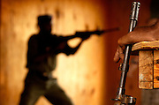 A policeman watches the more experienced squad demonstrate how to properly clear a room on Nov. 16, 2005. ..Djiboutian police train in counter terrorism messures with the US Marine Corps off the Horn of Africa.